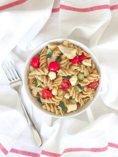 Hummus Pasta Salad With Whole Wheat Pasta, Hummus, Cooked Chicken, Cherry Tomatoes, Cucumber, Feta Cheese, Pepper, Salt