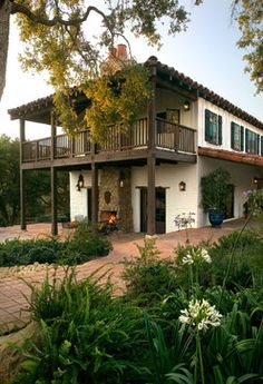 exposed beams at roof line, deck and patio. outside fireplace - white exterior with green shutters Two Story Balcony - rustic - Exterior - Santa Barbara - Tom Meaney Architect, AIA Design Exterior, Rustic Exterior, Spanish Style Homes, Spanish House, Spanish Revival, Spanish Colonial, Adobe Haus, Style Hacienda, Spanish Modern