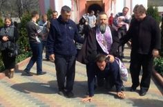 Fat orthodox priest caught riding a man like a donkey in a bizarre exorcism ritual