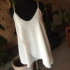 Off white tank NWT. Price only negotiable in bundle. I dont trade. Lush Tops Tank Tops