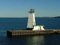 Ludington North Breakwater MI Source of Image:Larry Myhre (USA) Date of Image:January 1st, 2004    International Designation Number:  Unknown    Navigation: Latitude43° 57' 14'' N Longitude86° 28' 12'' W Body of waterLake Michigan.    Construction: Date of Establishment:1871 Date Light First Lit:1924 Designer Is structure still operating?Yes. Automated 1972. CharacteristicGreen light, 3sec on, 3sec off