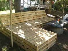 pallet sectional for outside, diy, pallet, repurposing upcycling, Still need to finish around edges and paint then make some cushions But so far its looking great