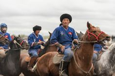 Professional kok-boru players getting ready for a match in Bishkek, Kyrgyzstan. In the sports, which is immensely popular in Central Asia, two teams on horseback battle to get a goat carcass into each other's goal.