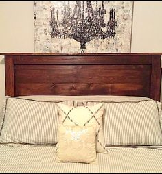 Reclaimed wood headboard. Reclaimed wood is not perfect. The wood has knicks- dents- etc- This adds to the CHARM. It is designed to be imperfect- an imperfect RUSTIC piece.  This ships in three pieces. Legs screw in with a power drill.  Made to attach to a standard metal frame.  120.00 flat rate shipping fee within US.  Kona stain is pictured.  Legs are 56 Inches high- Can adjust at no additional charge- include in comments. Ship times may vary slightly. We try to get headboards out as soon…