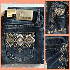 "Grace in L.A. Aztec Bling Bootcut Jeans NWTThese jeans ROCK! The Aztec designs on the open back pockets are stunning! There is a white logo patch with raised silver logo. The wash is dark with some distressing marks around knee area. The front is decorated on both side pockets with the repeated Aztec design on 5th pocket. These are sold out everywhere! Waist laying flat is 14""-14.5"" and inseam is 33""-34"". Grab them while they're hot! Grace in L. A. Jeans Boot Cut"