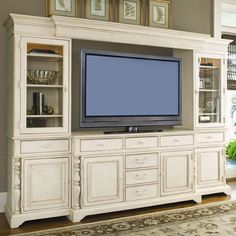 Distressed wood media console with eight drawers and adjustable shelves.   Product: Media consoleConstruction Material: