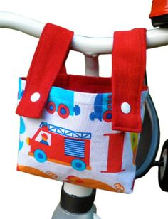 Easily sew a practical handlebar bag for a kid's bike. Makes a great birthday present or Halloween candy bag! PDF Sewing Pattern. Download free pattern here...