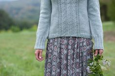 beautiful - I love cable panels that cut through bottom ribbing and still end in a clean line. Braeburn by Gudrun Johnston from 'knit with me'.