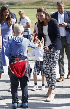 The Duchess was delighted to receive a small posy of flowers from a young boy...