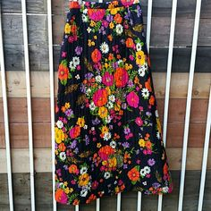 Vintage 1960s 1970s Floral Quilted Maxi Skirt Super cute 1960s or 1970s lightly quilted maxi skirt in black with a bright pink, orange, yellow, purple, white and green floral print. Made by Mr. B. of California. Measures about 13.5 inches flat across banded waist, so probably a modern small to smaller medium. Not perfect, but overall nice vintage condition. Like wearing a blankie! Vintage Skirts Maxi