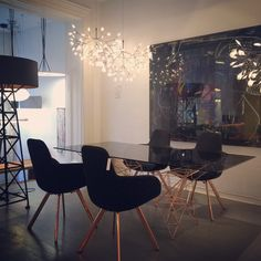 Tom Dixon's Pylon and Scoop Chairs with copper base at the Klaus showroom.