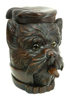 Black Forest style figural carved wood tobacco jar depicting a Scottish Terrier wearing a hat and smoking a cigar. Late 19th century