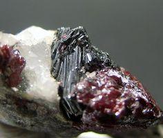 Polybasite, [Ag9CuS4] [(Ag,Cu)6(Sb,As)2S7], with Proustite, Ucchucchacua Mine, Oyón, Lima Department, Peru. Fov 15 mm. Copyright:slugslayer
