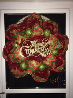Christmas Wreath with long Red roll for base and wide chevron print ribbon for second layer.