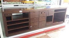 . Mostrador comercial, de 2.70 m x 70cm en color nogal, con multiples cajones y estantes, instalacion electrica  para tpv.