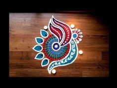 Here is a simple freehand diwali special flower rangoli design for Diwali. It is based on one of my original rangoli designs and I have tried to do some inno. Rangoli Colours, Rangoli Patterns, Rangoli Ideas, Rangoli Designs Diwali, Simple Rangoli, Free Hand Rangoli Design, Small Rangoli Design, Rangoli Designs With Dots, Arabic Mehndi Designs