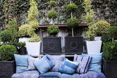 Unique blue pillows add beautiful color to an outdoor space.