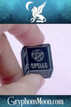 Spell Book Enamel Pin - Spell book… grimoire… book of shadows… whatever name you know it by, it's an essential part of any witch's library, stuffed full of charts and tables and recipes for the working of magic. Our Spell Book enamel pin isn't nearly that useful, but it does say, in no uncertain terms, here is someone with dark and dangerous knowledge. Cross them at your own risk. Visit our website to see more pins. #Witch #Wiccan #Pagan #SpellBook #Grimoire #BookOfShadows #EnamelPin… Wiccan, Pagan, Grimoire Book, Moon Logo, Samhain Halloween, Book Of Shadows, Lapel Pins, Spelling, Charts