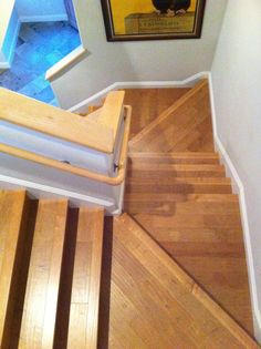 This is a stair case with angled landings and the floor is a 5″ hand scraped maple.