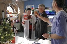 NCIS Christmas Episode  After a mysterious illness strikes children from military families, Gibbs and the team investigate the cause. Meanwhile, Abby and Jimmy partner with the Naval Medical Research Center to determine the strain of illness, all in hopes of delivering a cure before the holidays, on NCIS, Tuesday, Dec. 17. Pictured left to right: Meredith Eaton, Pauley Perrette, Mark Harmon and Brian Dietzen Photo: Sonja Flemming/CBS ©2013 CBS Broadcasting, Inc. All Rights Reserved