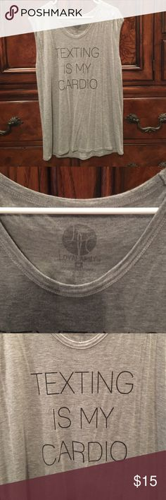 """Gray Tank Top Super cute and comfy Gray muscle tank top. Black printing with """"Texting is my cardio"""" on it. Size medium. Rayon & spandex Loyal Army Tops Tank Tops"""