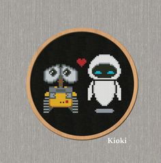 Wall-E and Eve Cross Stitch Pattern available for instant download via Etsy.