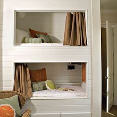 Each of these bunk bed cubbies in a shared kids' room feature a curtain that can be closed for a hideaway effect.  from babble.com