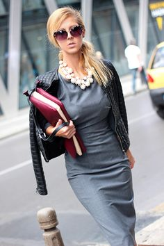Business with an edge. Black on gray with statement necklace and eye-catching bag.