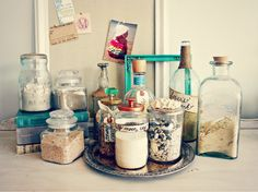 use sand bottles as decor (sand collected from vacations makes it more memorable)