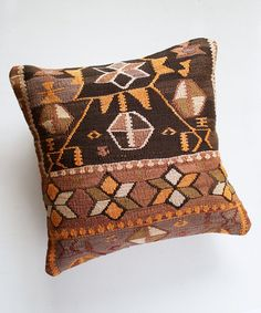 One-of-a-kind vintage Kilim pillow cover Approx. dimensions: 16x16 inches Cut from a 1960's vintage turkish handwoven kilim rug Back is sturdy tan-colored cotton with zip closure, insert not available