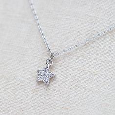 Tiny rhinestone star necklace in silver