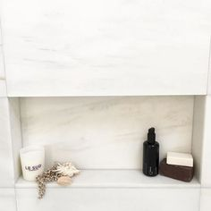 March Twice Interiors. Recessed shelving in the marble tiles above the bath in the ensuite bathroom of our #marchtwiceincremorne project. #marchtwice #interiordesign #marble #bathroom