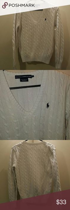White Polo v neck sweater White cable knit v neck sweater with a dark navy pony.  Really comfy great by itself or layering. Great condition, no rips or pulls in fabric Polo by Ralph Lauren Sweaters V-Necks