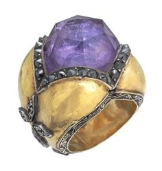 This looks Vintage but is hand-made by Sevan Bicakci according the information from a re-pinner amethyst, gold, and black diamond ring.