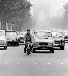 Champs Elysees Traffic Led by Actress Elsa Martinelli on Motorbike. photo by C. Bavagnoli for Life magazine, Paris, 1965 Life Magazine, Elsa Martinelli, La Provence France, Grand Prix, Dan Paris, Motorbike Photos, Moto Scooter, Photo Vintage, Ville France
