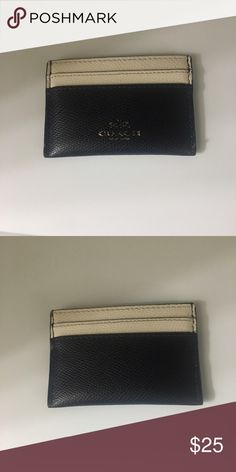 """Coach Credit Card Holder It has been used plenty of time, but still has a lot of life left. The """"coach"""" lettering is slowly wearing off. It is navy blue and creme Coach Accessories Key & Card Holders"""