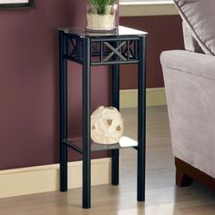 Monarch Accent Table - Black Metal With Tempered Glass With its classy glass top, this Plant Stand gives a warm feel to any room. Its original black metal base provides sturdy support as well as an elegant look. Use this multi-functional table to place your favorite plant or decorative piece. It is sure to be an eye-catcher. Metal Plant Stand with Tempered Glass Top, Black Home Furniture Living Room Furniture Plant Stands Telephone TablesWith its classy glass top, this Plant Stand gives a…