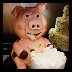Uh-oh. This little piggy got into the wedding cake en route to the ceremony...  #westtownbakery #customcake #pig #weddingtier #cake