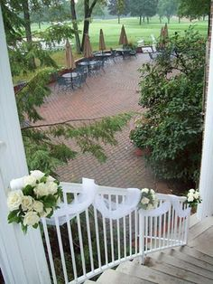 Michigan wedding outdoor decor staircase flowers ivory roses at barton hills country club