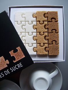 This just makes me grin: puzzle piece shaped sugar cubes from France. In three different types of sugar, no less.