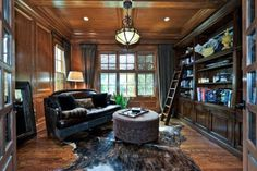 My B would love this office. French door entrance & built in mahogany shelving...possibly for a library.