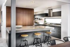Charcoal cabinets, walnut overhead cabinets, concrete benchtop, grey stone benchtop, timber overhead cabinets