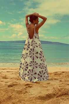 Low back maxi dress with adjustable straps. Love the style, not too keen on the pattern