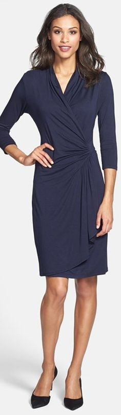 Ruching at the back neckline and waist creates soft elegance for a curve-hugging knit dress. A tapered drape of fabric cascades down the faux-wrap skirt.