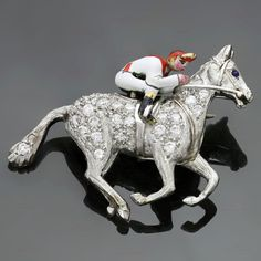 1930s Cartier Rare Art Deco Diamond Enamel Platinum Horse and Jockey Brooch | From a unique collection of vintage brooches at https://www.1stdibs.com/jewelry/brooches/brooches/