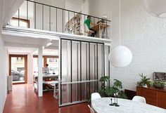 Love those 'barn doors' that could completely separate kitchen and living room!