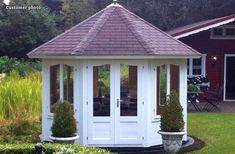 An octagonal summer house can be used to punctuate garden design, or to link two different planting areas together. Painted in white, the Tweed summer house in this GardenLife photo adds real elegance to the garden. Octagonal Summer House, Garden Structures, Outdoor Structures, Storing Garden Tools, Timber Logs, Garden Pavilion, Corner Garden, She Sheds, Double Glazed Window