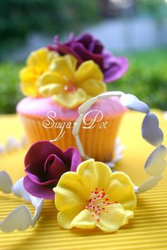 yellow and purple cupcakes