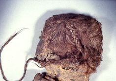 The Elling Woman - a bog mummy discovered in Silkeborg, Denmark in 1938 by a local farmer who at first believed it was a drowned animal. She was found wrapped in a sheepskin with a leather cloak tied about her legs. She died around 280 BC by hanging (just like Tollund Man). Her well preserved hair, which was 90 centimeters long, was braided and tied into a knot. Elling Woman is believed to have been a human sacrifice.