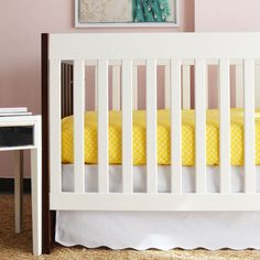 White Scalloped Crib Skirt - it's the perfect neutral skirt that adds just a touch a fun with the scalloped edges.